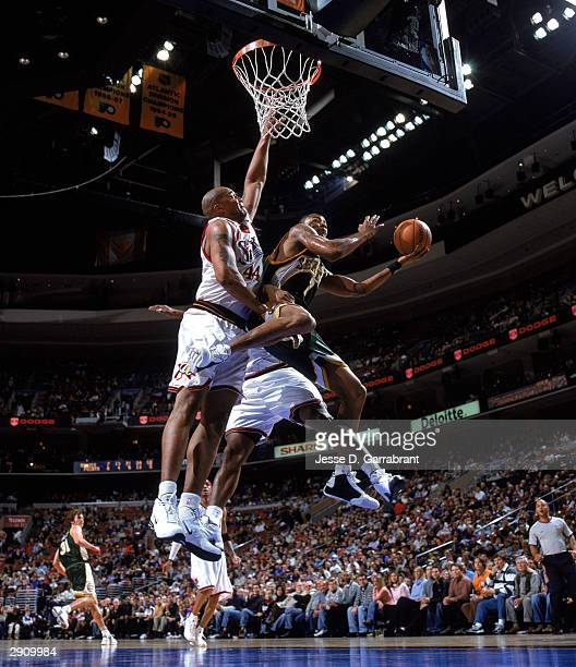 Rashard Lewis of the Seattle Sonics takes the ball to the basket against Derrick Coleman of the Philadelphia 76ers during the NBA game at Wachovia...