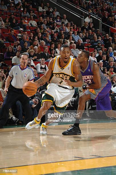 Rashard Lewis of the Seattle SuperSonics drives to the basket past James Jones of the Phoenix Suns during a game at Key Arena on February 14 2007 in...