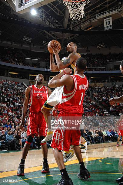 Rashard Lewis of the Seattle SuperSonics goes for the basket against Tracy McGrady of the Houston Rockets on April 9 2007 at the Key Arena in Seattle...