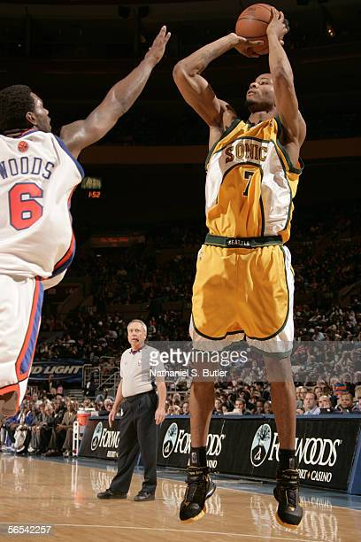 Rashard Lewis of the Seattle SuperSonics shoots against Qyntel Woods of the New York Knicks at Madison Square Garden on January 8 2006 in New York...