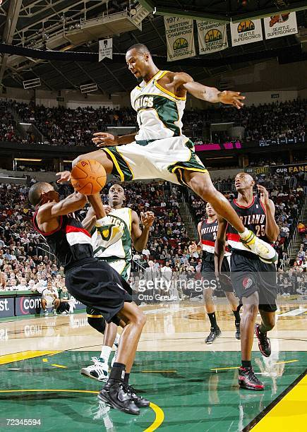 Rashard Lewis of the Seattle SuperSonics shoots and fouls Juan Dixon of the Portland Trail Blazers on November 1 2006 at Key Arena in Seattle...