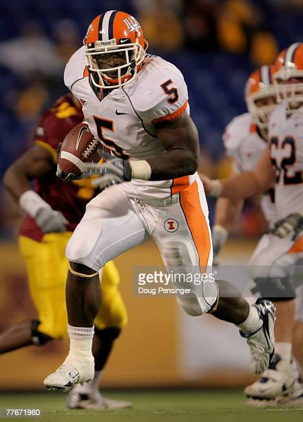 Rashard Mendenhall of the Illinois Fighting Illini rushes 33 yards for a fourth quarter touchdown against the Minnesota Golden Gophers at the Hubert...