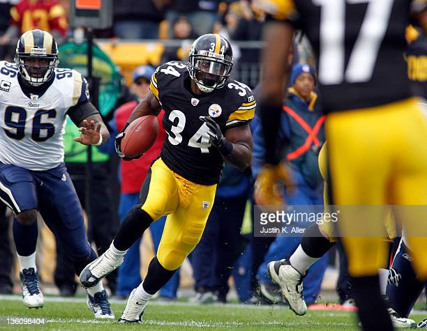 Rashard Mendenhall of the Pittsburgh Steelers carries the ball against the St Louis Rams during the game on December 24 2011 at Heinz Field in...