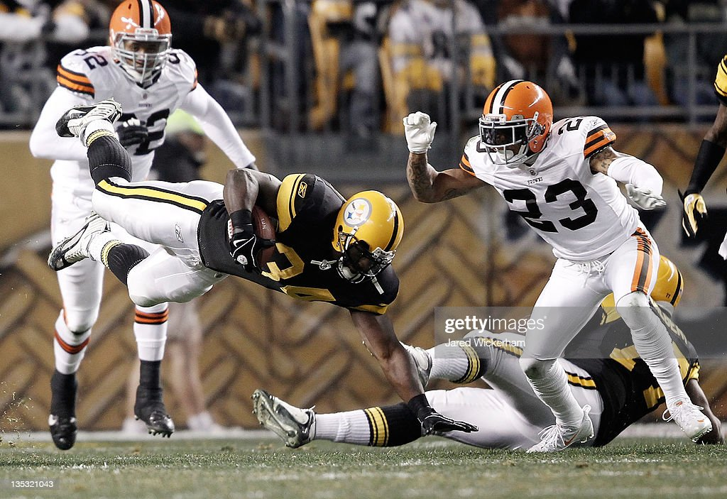 Rashard Mendenhall #34 of the Pittsburgh Steelers dives with the ball in front of Joe Haden #23 of the Cleveland Browns during the game on December 8, 2011 at Heinz Field in Pittsburgh, Pennsylvania.