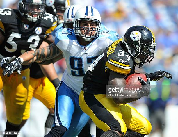 Rashard Mendenhall of the Pittsburgh Steelers is tackled by Jason Babin of the Tennessee Titans at LP Field on September 19 2010 in Nashville...