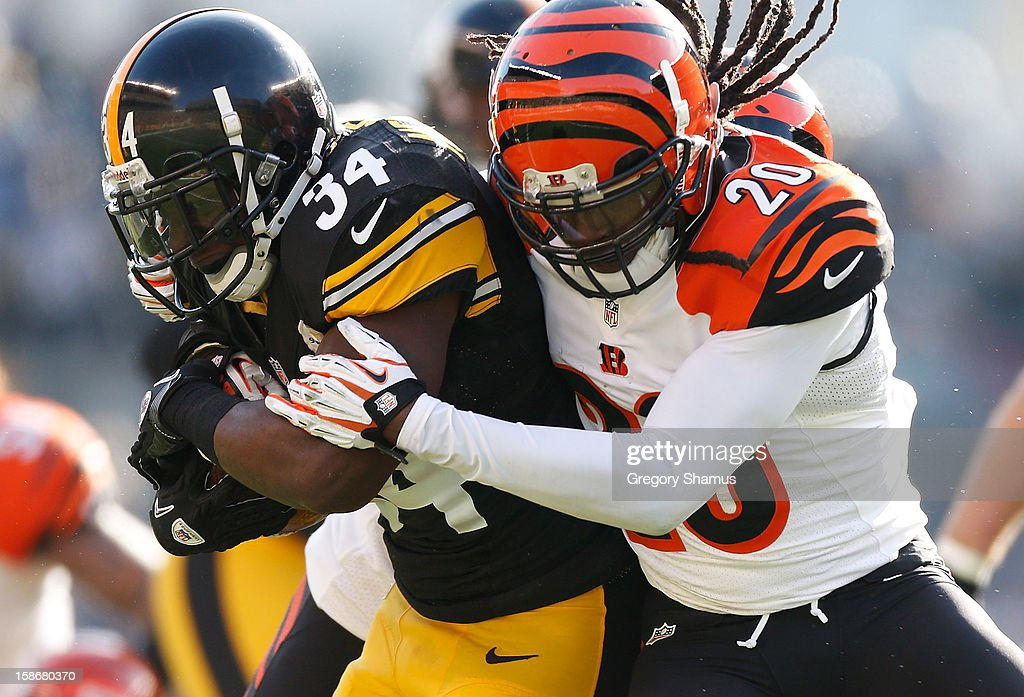 Rashard Mendenhall #34 of the Pittsburgh Steelers is tackled during a second quarter run by Reggie Nelson #20 of the Cincinnati Bengals at Heinz Field on December 23, 2012 in Pittsburgh, Pennsylvania.