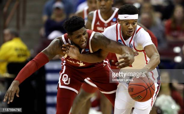 Rashard Odomes of the Oklahoma Sooners and Devontae Shuler of the Mississippi Rebels compete for a loose ball in the first half during the first...