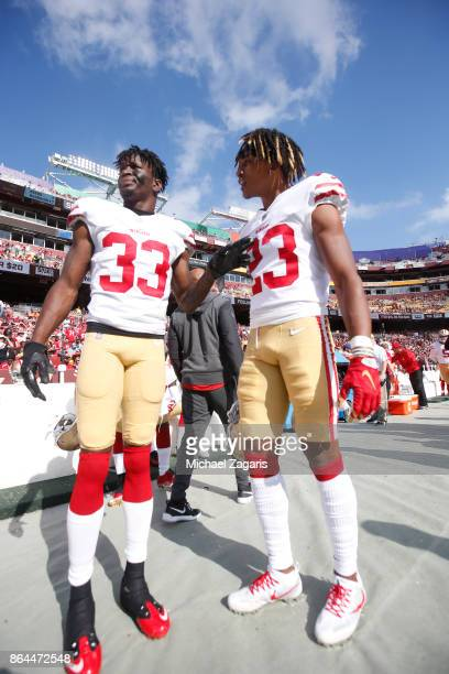 Rashard Robinson and Ahkello Witherspoon of the San Francisco 49ers talk on the sideline during the game against the Washington Redskins at FedEx...