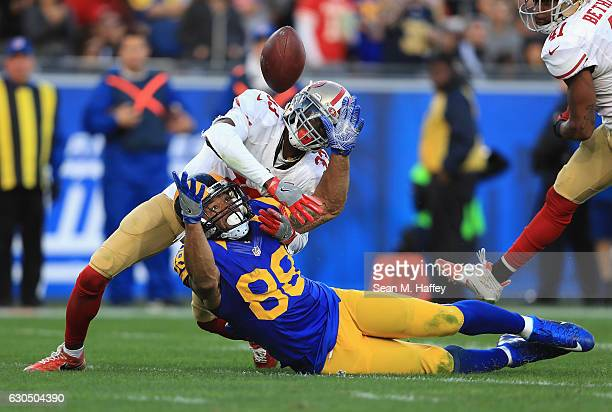 Rashard Robinson of the San Francisco 49ers breaks up a pass intended for Lance Kendricks of the Los Angeles Rams during the second half of their...