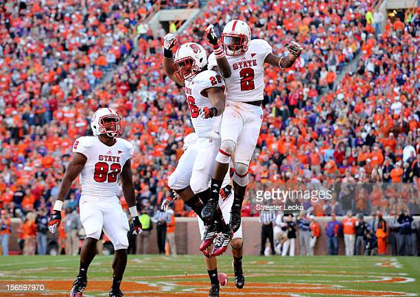 Rashard Smith of the North Carolina State Wolfpack celebrates after making a touchdown catch with teammate Tony Creecy during their game against the...