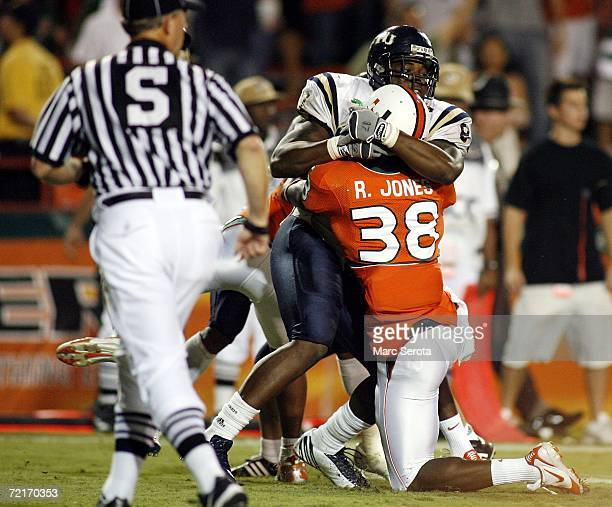 RaShaun Jones of the University of Miami Hurricanes scuffles with Samuel Smith of the Florida International University Panthers during a fight on the...