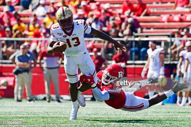 Rashawn Battle of the Rutgers Scarlet Knights is stopped by Anthony Brown of the Boston College Eagles to face a field goal heading into halftime...
