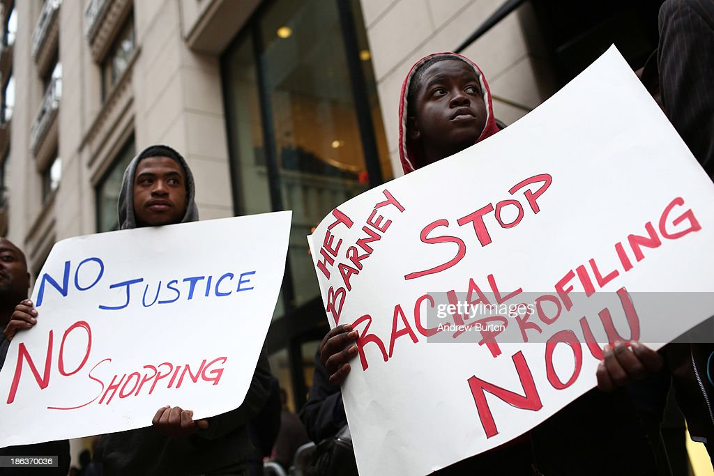 Rashawn Moose Cheatham (L) and Tyreik Jackson protest outside Barney's flagship store, accusing the store of racial profiling, on October 30, 2013 in New York City. On April 29, 2013 Trayon Christian, 19, was detained and then arrested by undercover police after buying a $349 belt at Barney's.
