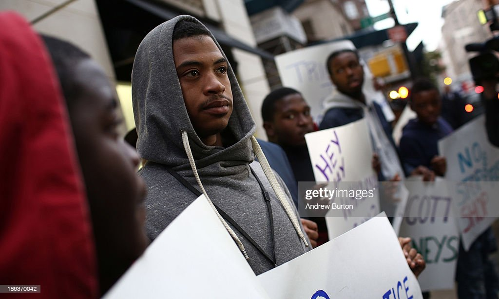 Rashawn Moose Cheatham protests outside Barney's flagship store, accusing the store of racial profiling, on October 30, 2013 in New York City. On April 29, 2013 Trayon Christian, 19, was detained and then arrested by undercover police after buying a $349 belt at Barney's.