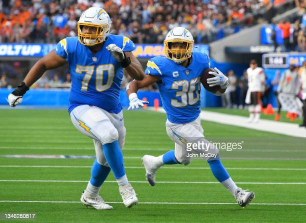Rashawn Slater blocks for Austin Ekeler of the Los Angeles Chargers in a game against the Cleveland Browns at SoFi Stadium on October 10, 2021 in...