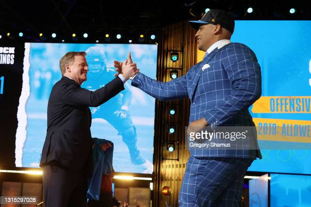 Rashawn Slater greets NFL Commissioner Roger Goodell onstage after being selected 13th by the Los Angeles Chargers during round one of the 2021 NFL...