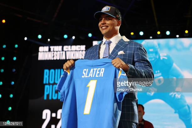 Rashawn Slater poses onstage after being selected 13th by the Los Angeles Chargers during round one of the 2021 NFL Draft at the Great Lakes Science...