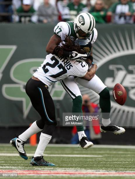 Rashean Mathis of the Jacksonville Jaguars forces a fumble against Braylon Edwards of the New York Jets during the third quarter on November 15, 2009...