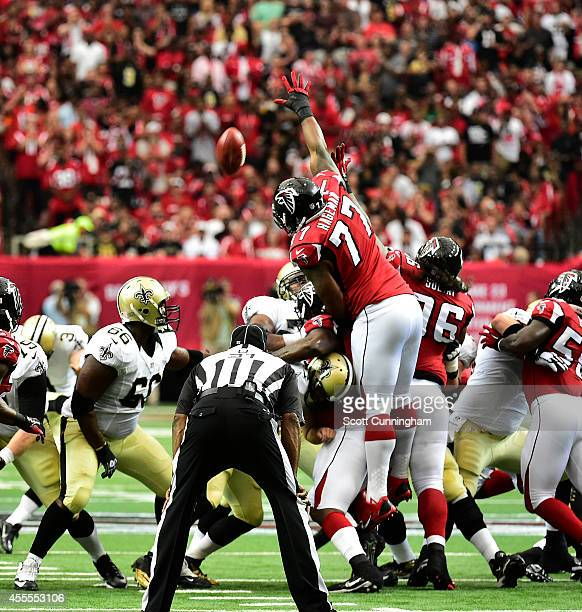 Ra'Shede Hageman of the Atlanta Falcons attempts to block a field goal against the New Orleans Saints at the Georgia Dome on September 7 2014 in...