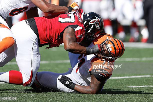 Ra'Shede Hageman of the Atlanta Falcons knocks down Andre Smith of the Cincinnati Bengals during the fourth quarter at Paul Brown Stadium on...