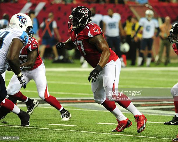 Ra'Shede Hageman of the Atlanta Falcons rushes the passer in a preseason game against the Tennessee Titans at the Georgia Dome on August 23 2014 in...