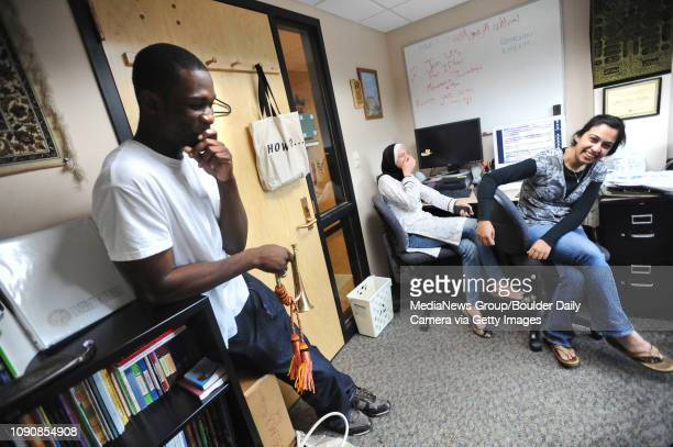 Rasheed Lawal left a University of Colorado student who is a member of the Muslim Students Association laughs after blowing a horn that hangs in the...