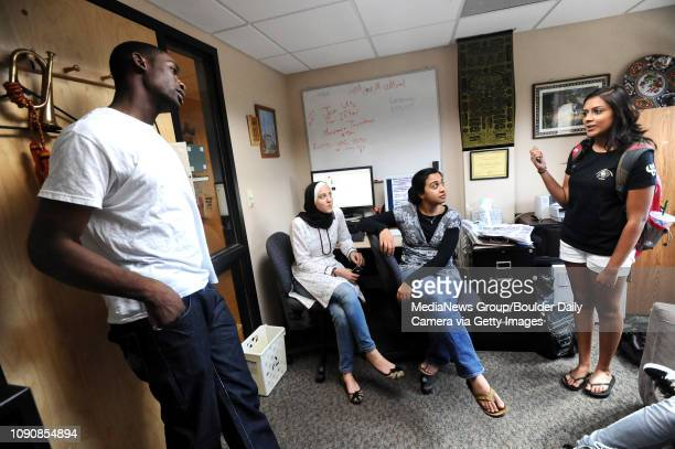 Rasheed Lawal left a University of Colorado student who is part of the Muslim Students Association talks with Meera Shah right the president of the...