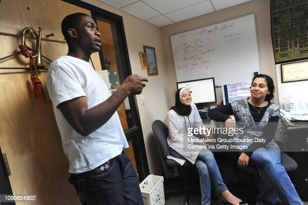 Rasheed Lawal left a University of Colorado student who is part of the Muslim Students Association talks with Saira Siraj center and Amana Malik...