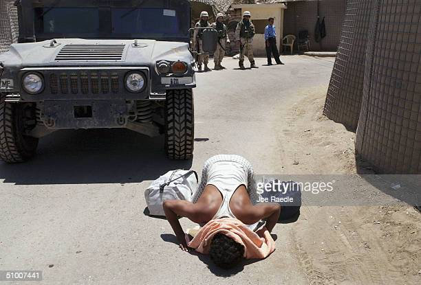 Rasheed Rahman a former prisoner of the United States military operated Abu Ghraib prison kisses the ground after he was transported and released on...