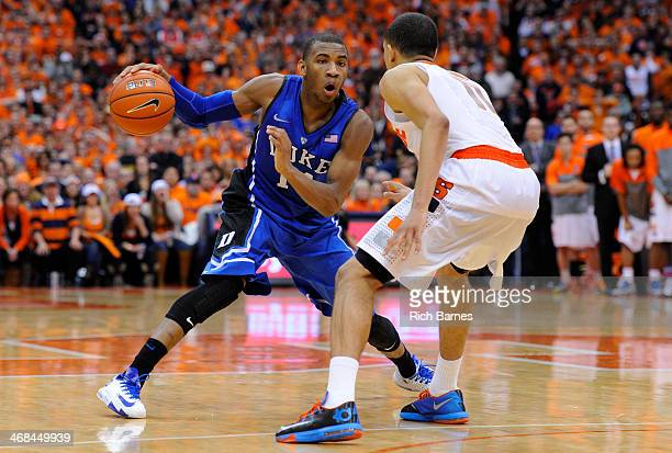 Rasheed Sulaimon of the Duke Blue Devils drives to the basket against the defense of Tyler Ennis of the Syracuse Orange during the second half at the...