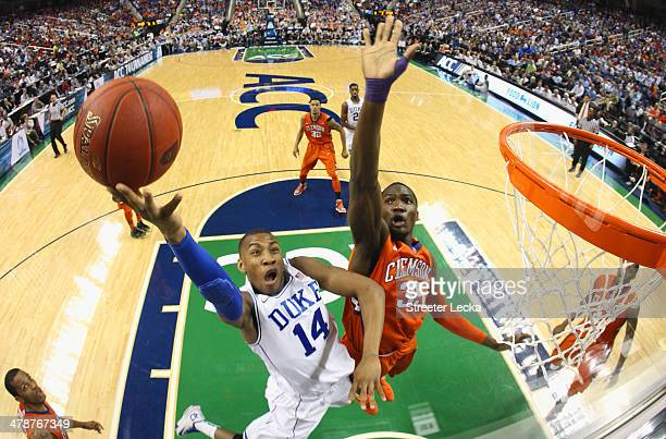 Rasheed Sulaimon of the Duke Blue Devils drives to the basket against Landry Nnoko of the Clemson Tigers during the quarterfinals of the 2014 Men's...