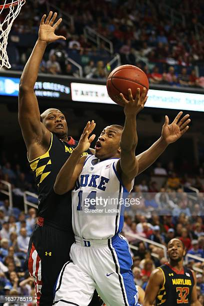 Rasheed Sulaimon of the Duke Blue Devils goes up against Charles Mitchell of the Maryland Terrapins in the first half of their game during the...