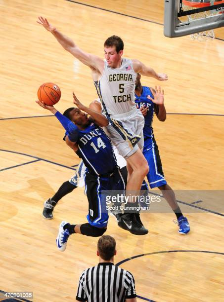 Rasheed Sulaimon of the Duke Blue Devils has his shot blocked by Daniel Miller of the Georgia Tech Yellow Jackets at McCamish Pavilion on February 18...