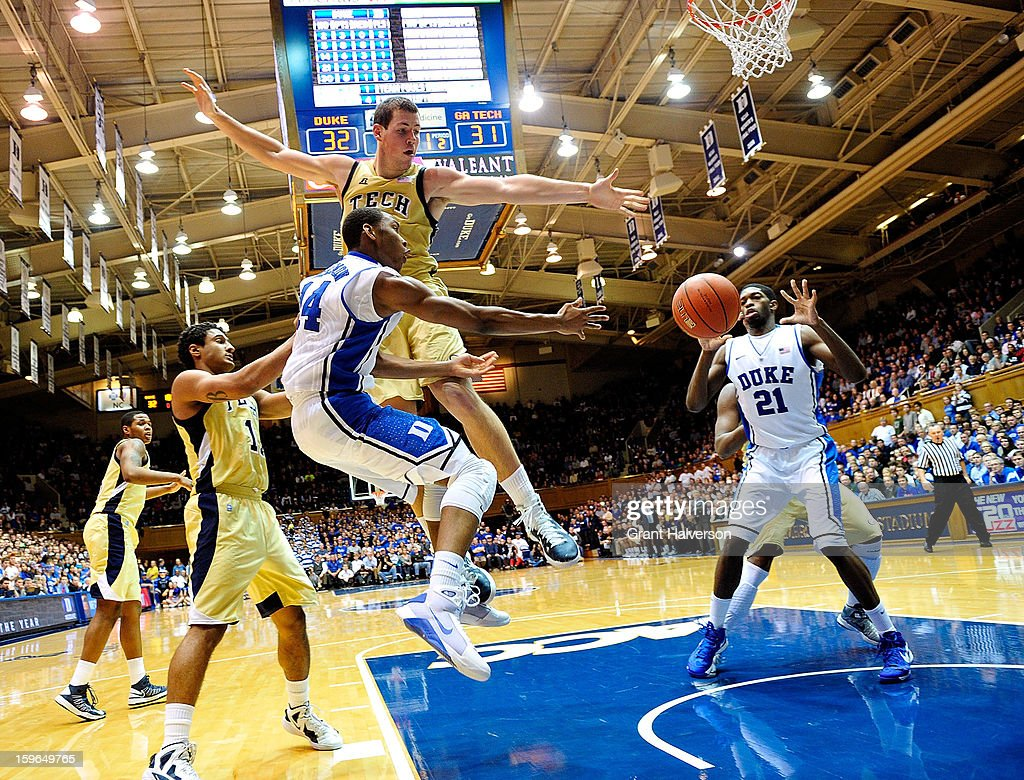 Rasheed Sulaimon #14 of the Duke Blue Devils passes to teammate Amile Jefferson #21 in the lane as he is defended by Daniel Miller #5 of the Georgia Tech Yellow Jackets during play at Cameron Indoor Stadium on January 17, 2013 in Durham, North Carolina. Duke won 73-57.