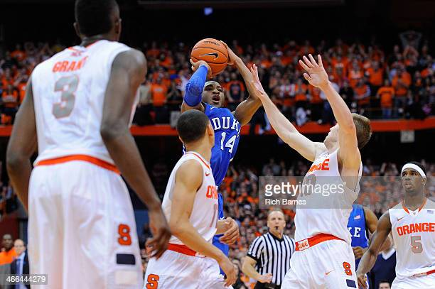 Rasheed Sulaimon of the Duke Blue Devils takes a shot over Trevor Cooney of the Syracuse Orange during the second half at the Carrier Dome on...