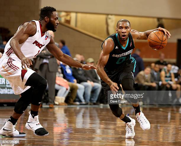 Rasheed Sulaimon of the Greensboro Swarm drives against Ike Nwamu from the Sioux Falls Skyforce at the Sanford Pentagon November 29 2016 in Sioux...