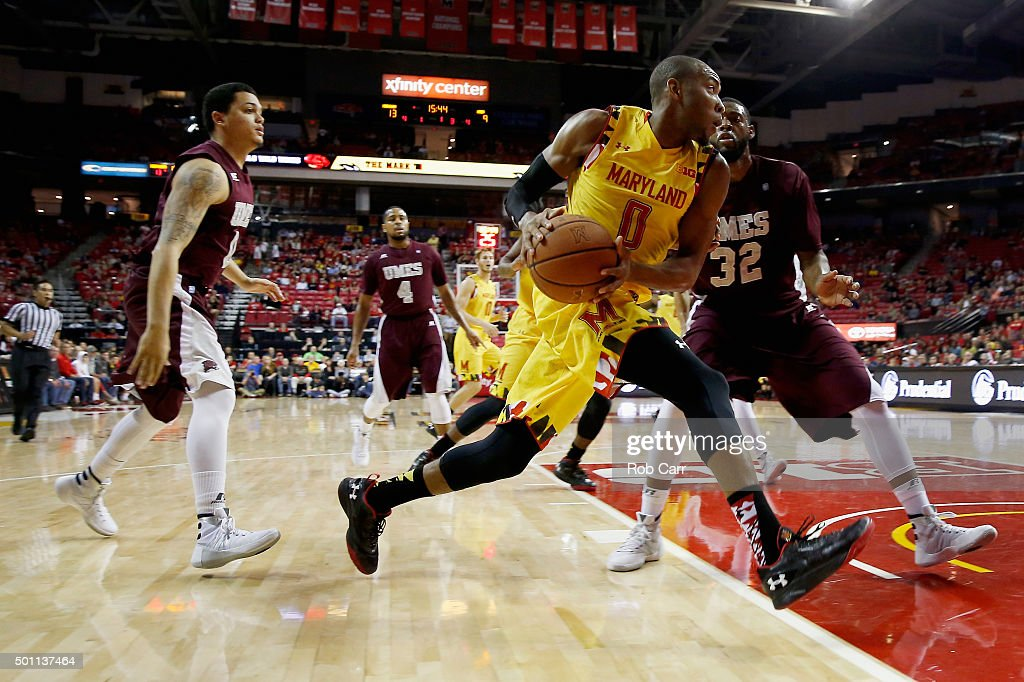 rasheed sulaimon 0 of the maryland terrapins drives against dominique elliott 32 of the