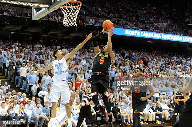 Rasheed Sulaimon of the Maryland Terrapins shoots the ball over Marcus Paige of the North Carolina Tar Heels at Dean Smith Center on December 1 2015...