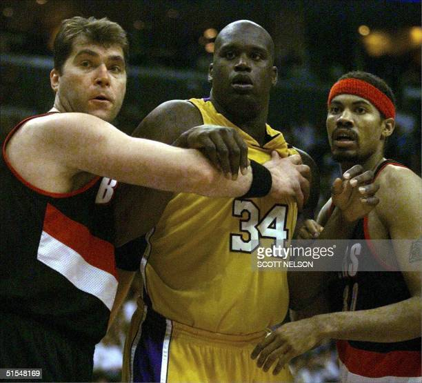 Rasheed Wallace and Arvydas Sabonis of the Portland Trail Blazers double team Shaquille O'Neal of the Los Angeles Lakers during Game Two of the NBA...