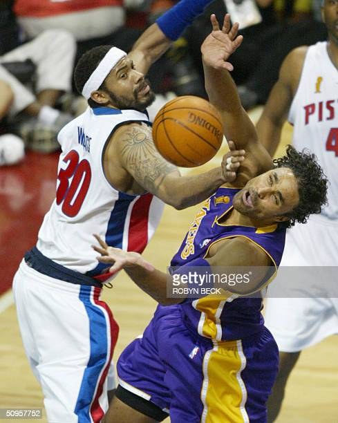 Rasheed Wallace of the Detroit Pistons and Rick Fox of the Los Angeles Lakers struggle for a rebound during second half action in game four of the...