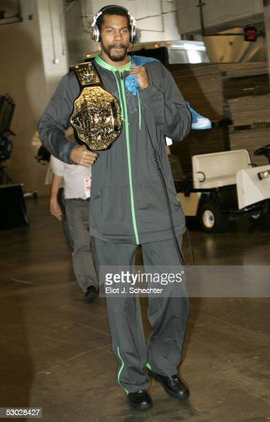 Rasheed Wallace of the Detroit Pistons arrives at the arena carrying his championship belt for Game Seven of the Eastern Conference Finals against...