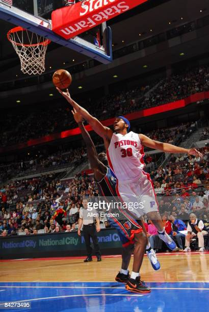 Rasheed Wallace of the Detroit Pistons attempts a shot against Emeka Okafor of the Charlotte Bobcats in a game at the Palace of Auburn Hills on...