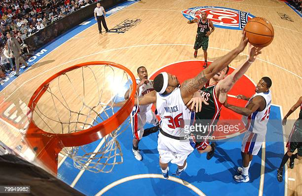 Rasheed Wallace of the Detroit Pistons blocks a shot attempt by Andrew Bogut of the Milwaukee Bucks on February 22, 2008 at the Palace of Auburn...