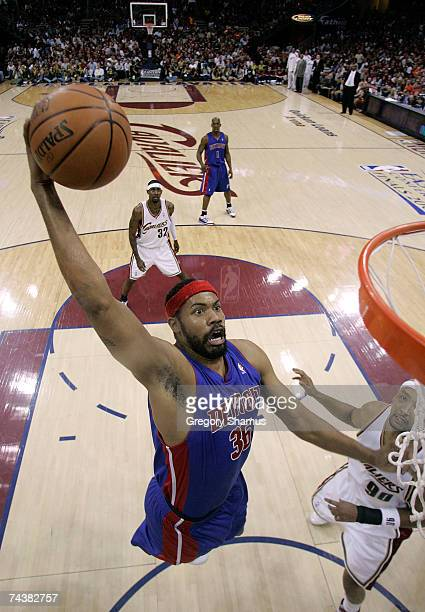 Rasheed Wallace of the Detroit Pistons dunks against Drew Gooden of the Cleveland Cavaliers in Game Six of the Eastern Conference Finals during the...