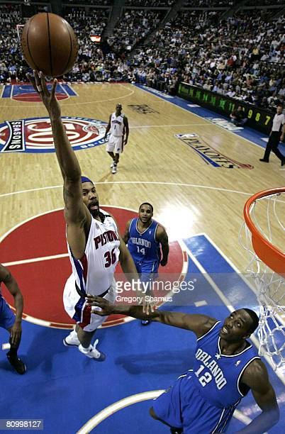 Rasheed Wallace of the Detroit Pistons gets a shot off over Dwight Howard of the Orlando Magic during Game Two of the Eastern Conference Semifinals...