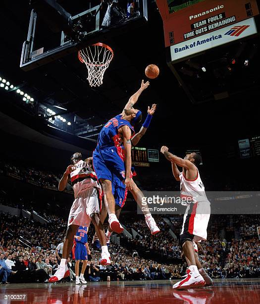 Rasheed Wallace of the Detroit Pistons goes up for a rebound during the game against the Portland Trail Blazers at The Rose Garden on March 4 2004 in...