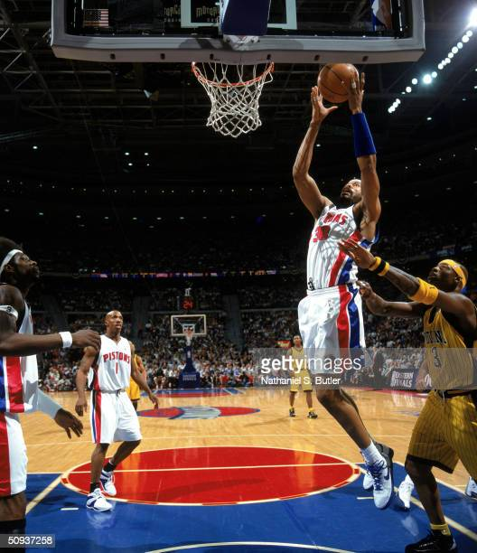 Rasheed Wallace of the Detroit Pistons lays up a shot against Al Harrington of the Indiana Pacers in Game six of the Eastern Conference Finals during...
