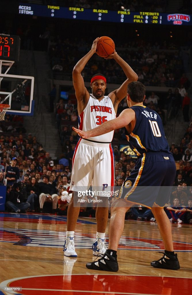 Rasheed Wallace #36 of the Detroit Pistons looks to pass against Jeff Foster #10 of the Indiana Pacers during a game at the Palace of Auburn Hills on December 29, 2006 in Auburn Hills, Michigan. The Pacers won 93-92.