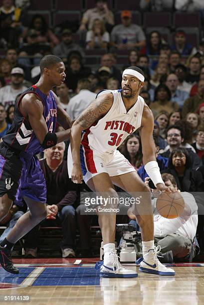 Rasheed Wallace of the Detroit Pistons moves the ball during the game with the Toronto Raptors on March 10, 2004 at the Palace of Auburn Hills in...