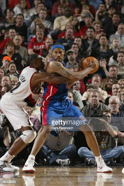Rasheed Wallace of the Detroit Pistons posts up against Theo Ratliff of the Portland Trail Blazers March 4 2004 at the Rose Garden Arena in Portland...